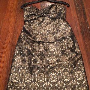 Nicole Miller gold/metallic strapless mini-dress.